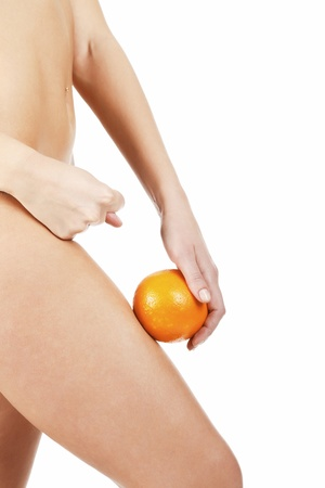 Slim woman shows the fig to cellulite, isolated on white background