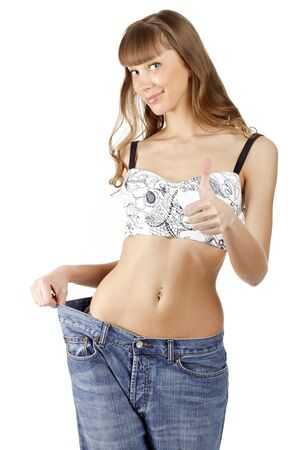 Woman loosing weight and showing a thumb up sign, isolated on white background.  Stock Photo - 9032532