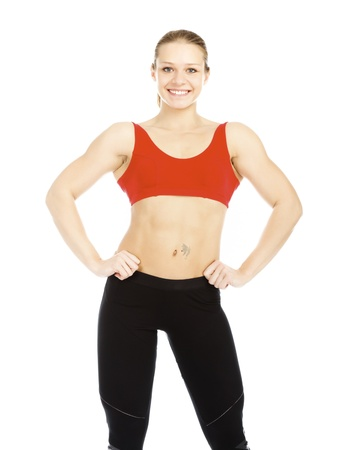 Pretty fitness instructor posing against white background. photo