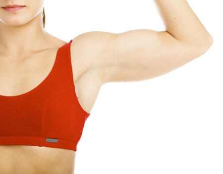 muscular woman posing agaisnt white background photo