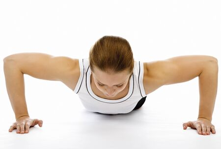 Woman doing pushups on white floor Stock Photo - 9250503