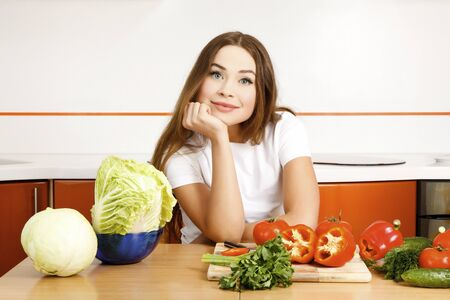 beautiful caucasian woman preparing salad in the kitchen. Stock Photo - 9325203