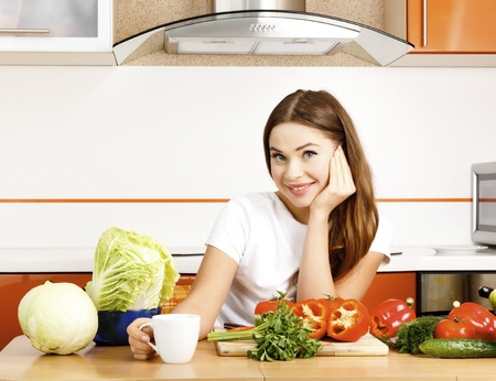 beautiful caucasian woman in the kitchen  photo