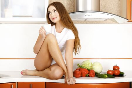 beautiful caucasian woman in the kitchen.  photo
