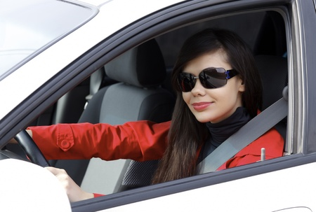 Pretty brunette driving a car.  photo