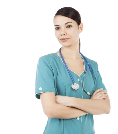 nurse uniform: Retrato de mujer m�dico o enfermera con estetoscopio posando sobre fondo blanco