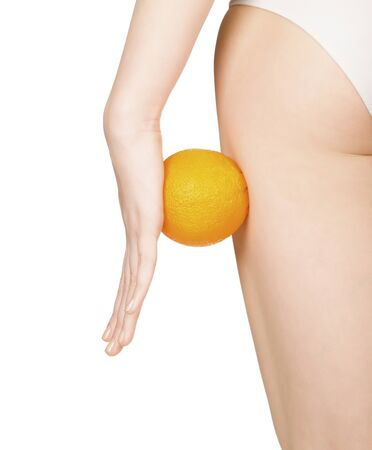 cellulite: beautiful female figure with orange, isolated on white background   Stock Photo