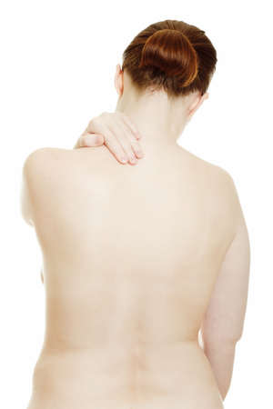 Osteochondrosis - woman massaging pain back, isolated over a white background. Stock Photo - 9742026