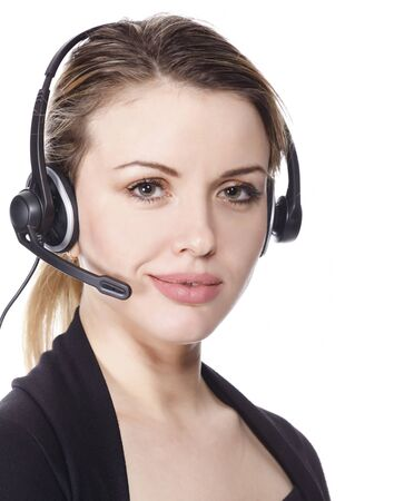 Cute smiling woman with headset - isolated over a white background. Stock Photo - 9847694
