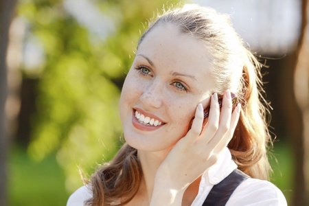 young woman talking on her mobile phone outdoors Stock Photo - 9967229