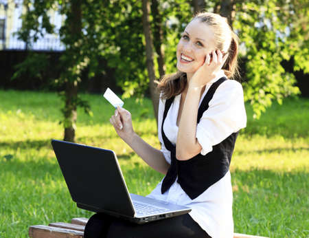 Beautiful Woman with Credit Card Using Her Laptop  photo