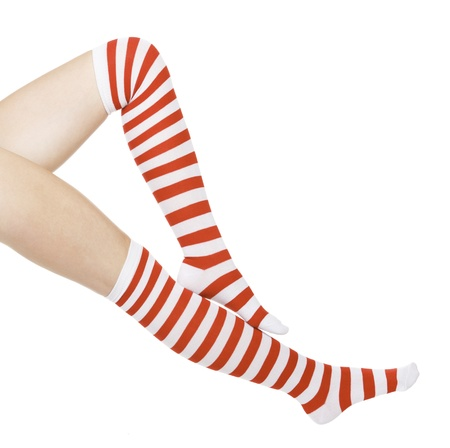 woman legs in color red socks isolated on white  photo