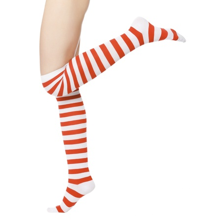 woman legs in color red socks isolated on white.  photo