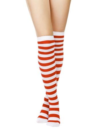 Christmas female legs, isolated on white background  photo