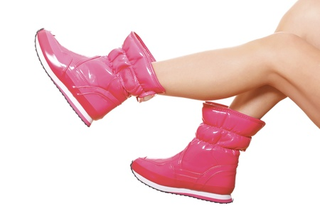 Pink wellies on the female legs photo