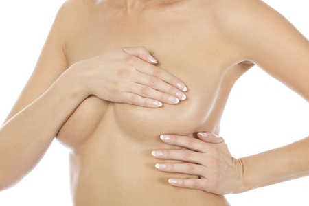 breast examination: Breast cancer, woman holding her breast, isolated on white background