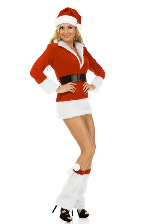 Beautiful and sexy woman wearing Santa Clause costume, isolated on white background photo