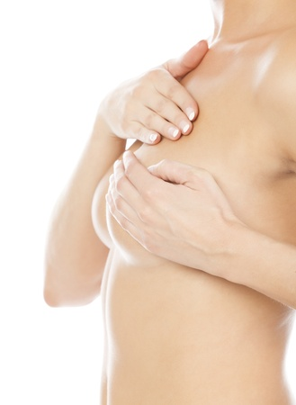 breast beauty: Breast cancer, woman holding her breast, isolated on white background