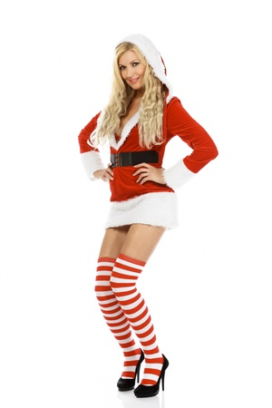 Beautiful and sexy woman wearing Santa Clause costume, isolated on white background. photo