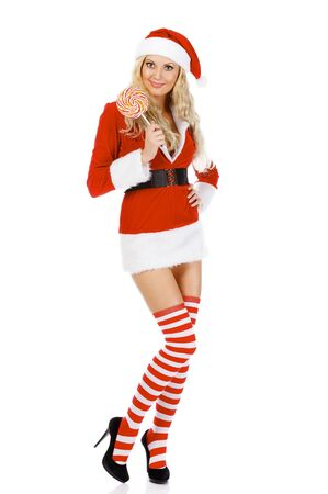 Santa girl with lollypop, isolated on white background photo