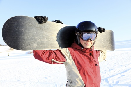 Female snowboarder on the snowhill.  Stock Photo