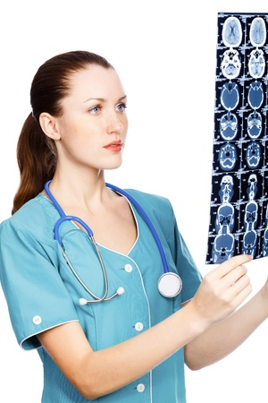 Young female doctor checking MR. Isolated over a white background.  photo