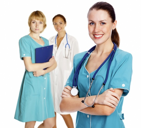 Hospital team. Three healthcare workers on white background photo