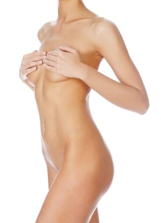 mujer desnuda: Cuerpo de la mujer hermosa aisladas sobre fondo blanco claro Foto de archivo