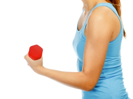 Female hand with a red barbell, isolated on white  photo