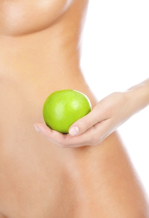 Beautiful woman body and green apple. Isolated on white background photo