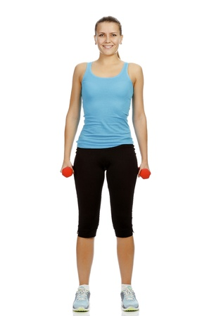 Smiling woman with barbells standing on a white floor Stock Photo - 11741472