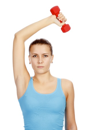 Pretty woman with red barbell posing against white background Stock Photo - 11741476