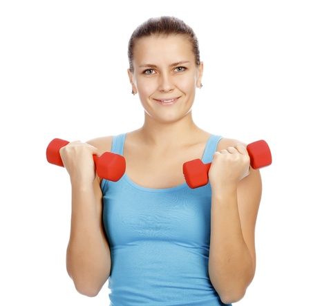 Pretty woman with red barbells posing against white background photo