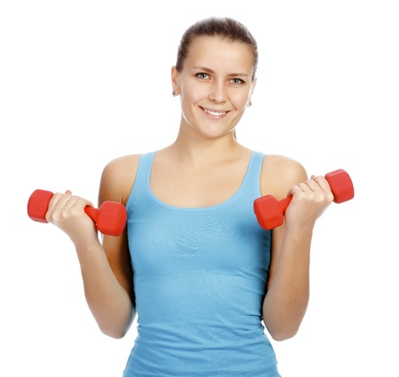 Pretty woman with red barbells posing against white background Stock Photo - 11741479