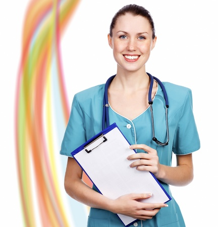 Smiling doctor against abstract background with space of your text  photo