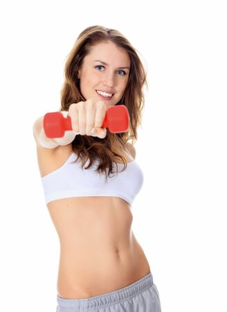 Pretty girl with red barbells posing against white background photo