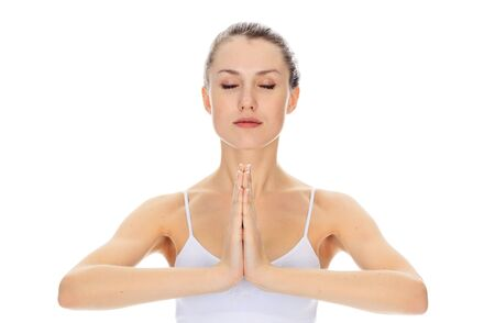 meditating girl posing against white background Stock Photo - 11960612