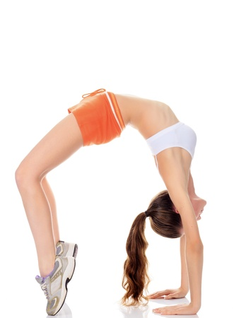 beautiful fitness girl exercising gymnastic bridge, isolated on white background  photo