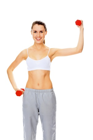 woman lifting weights: Pretty happy young woman exercising with free weights. Isolated on white background Stock Photo