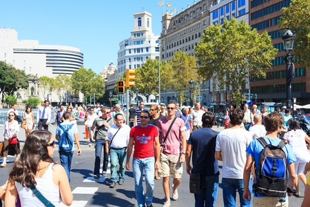 BARCELONA - SEPTEMBER 15, 2011: Many of tourists strolling across the center of the city on September 15, 2011 in Barcelona. It is one of the busiest pedestrian areas in Barcelona
