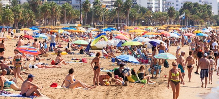 Salou, Spain - September 22, 2011: Many of tourists rest along Salou beach on September 22, 2011