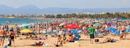 senile: Salou, Spain - September 22, 2011: Many of tourists rest along Salou beach on September 22, 2011 Editorial