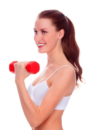 Smiling woman with barbells posing against white background photo