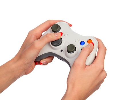 gamepad: Female hands with a gamepad. Isolated on white background Stock Photo