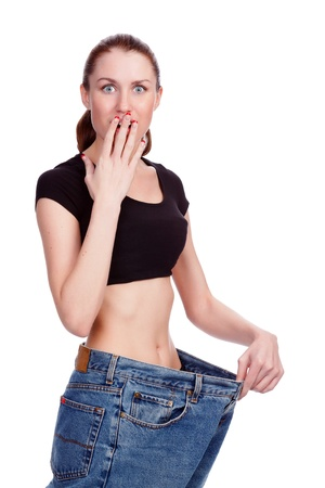 successful weight loss. girl posing against white background Stock Photo - 12183818