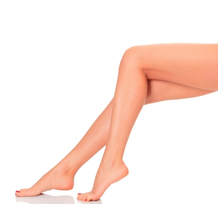 female nudity: Perfect female legs, isolated on white background  Stock Photo