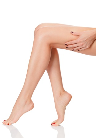 No cellulite. Perfect long female legs against white background photo