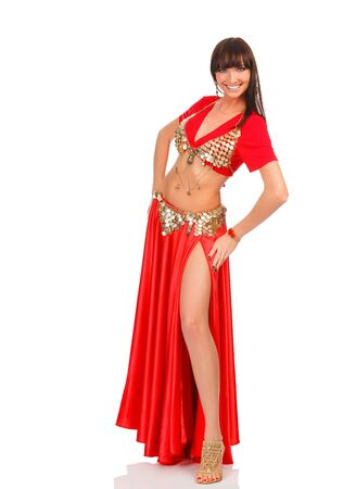 Belly dancer in red dress, isolated on a white background  photo