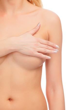 femme se deshabille: seins de femme � examiner, isol� sur blanc Banque d'images