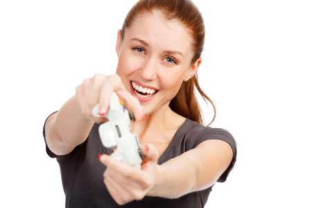 exclaiming: Playing girl with a game controller, isolated on white background